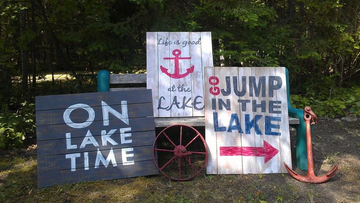 Reclaimed wood from garage used to make the base, then used DecoArt Inc. Americana Chalk paint to paint the signs