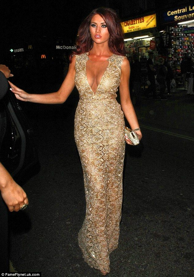 All that glitters: Amy Childs wore a gold full length gown with a plunging neckline. Beautiful dress