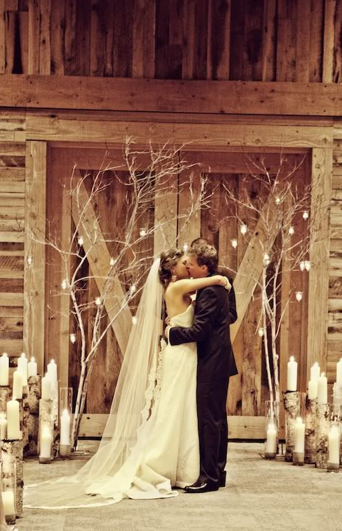 Trees and tons of candles.these would be cute everywhere, in Logan and St. George, and easy to do. Cheap!!! reuse in your reception space after the ceremony.                                                                                                                                                                                 More