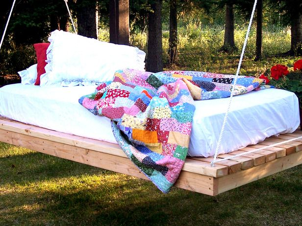 Swinging Bed in the Garden DIY Tutorial    http://www.hgtv.com/outdoor-rooms/easy-diy-hanging-daybed/index.html #swinging #bed #diy #garden #tutorial