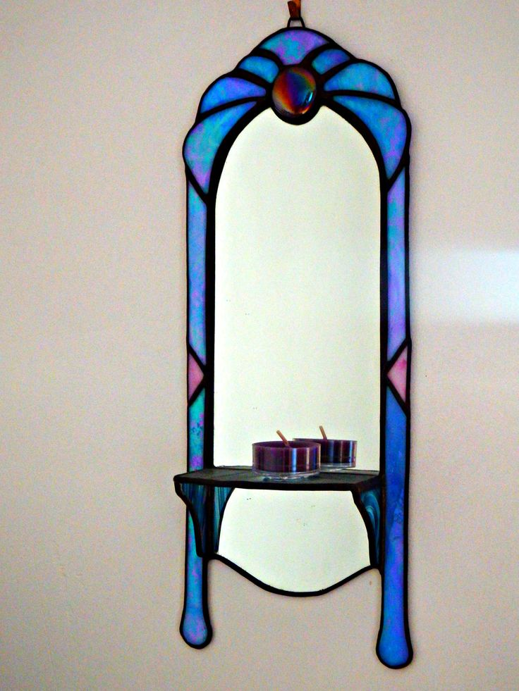 OMG THIS IS GLOWING!! It's like a cartoon/storybook mirror.    Blue Sconce - handmade stained glass