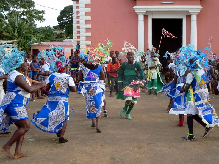 Traditional dancers perform in front of the Igreja de São Pedro at Pantufo on Sao Tome Island, São Tomé and Príncipe.