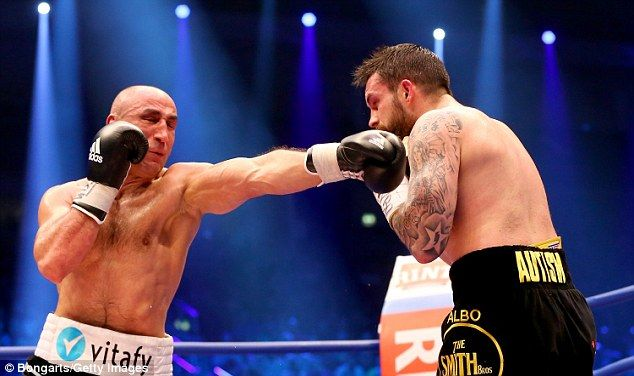 Germany's Arthur Abraham lands a punch on his opponent Paul Smith of Great Britain...