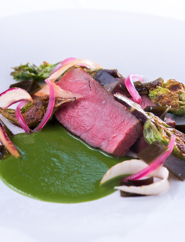 Paul Foster uses Irish beef striploin to create this striking dish of tender pink meat, cooked medium-rare, and a vibrant green purée of alexanders and parsley.