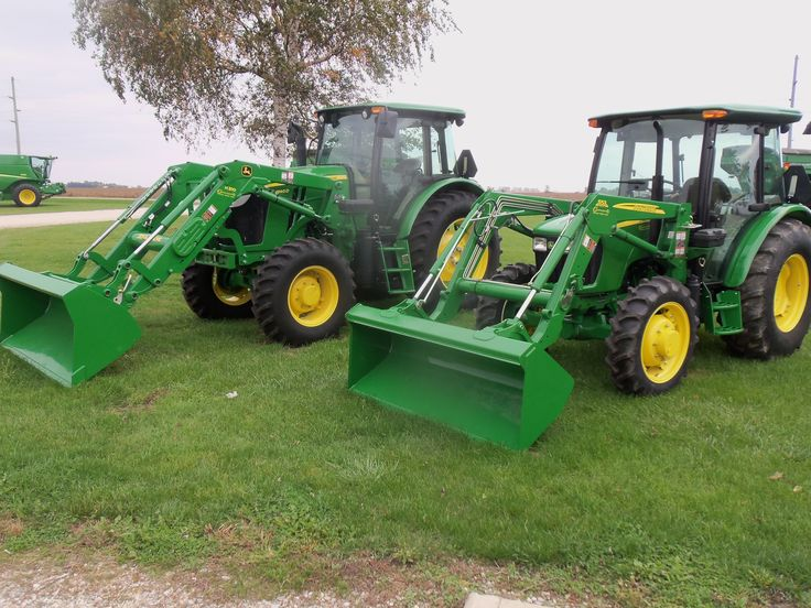 JOhn Deere  5055E with  553 loader on right & 6140D equipped H310 loader on left