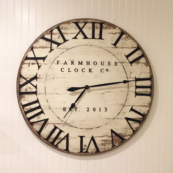 The Extra Large Roman Numeral Farmhouse Clock Co. is a beautiful addition to any country Farmhouse style home. The clock is made of solid wood and measures 30-40 inches across and 1 inch thick. Variations in size and color available. The numbers and lettering are 1/8th inch thick wooden pieces that give the face of the clock dimension. The hands are black metal. The clock shown is Dist.White/Black#  ***Please notate in the comments when you order what year you would like after the Est. date…