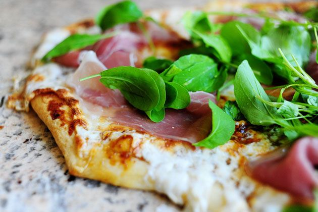 Probably my favorite pizza recipe: Fig, prosciutto, and arugula with buffalo mozzarella and parmesan.