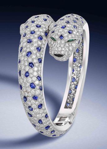 "A diamond, sapphire, emerald and onyx ""Panthère"" bracelet, by Cartier"