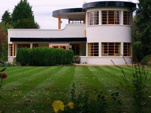 Art Deco Architecture : Popular during 1925 - 1940:Green Art Deco Architecture Arched House Wall Art Deco Architecture by bertadeluca