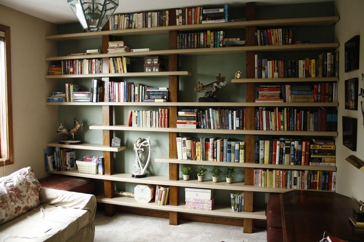 I have a collection of books and trinkets gathered from around the globe. I would like to store in in a full wall shelf. Maybe in family room? Need to know: how to apply safety glass for the shelf, and whether it will look good.