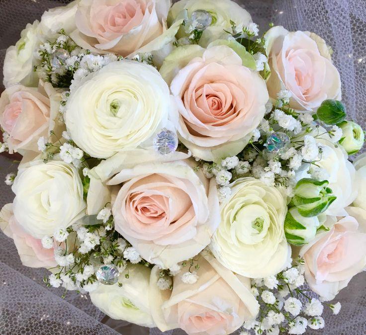 Posy of soft peach roses, white renuncula's, and gypsophila.  Made by Karen. Sweet Wattle Grove Florist.