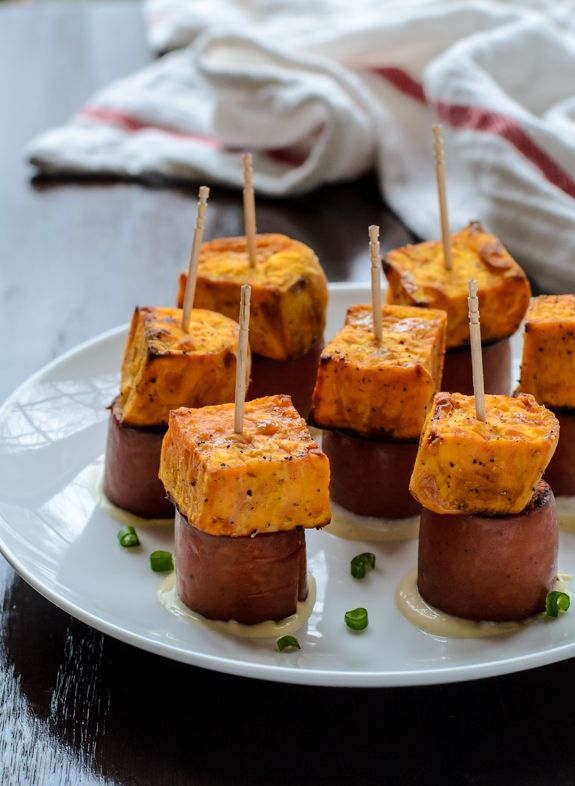 An easy healthy appetizer recipe: Chunks of roasted sweet potatoes paired with juicy andouille chicken sausage and a zesty Dijon dipping sauce.