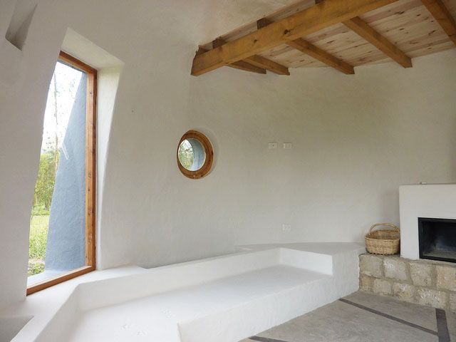 Inside a modern earthbag house this one is built in for Adobe construction cost