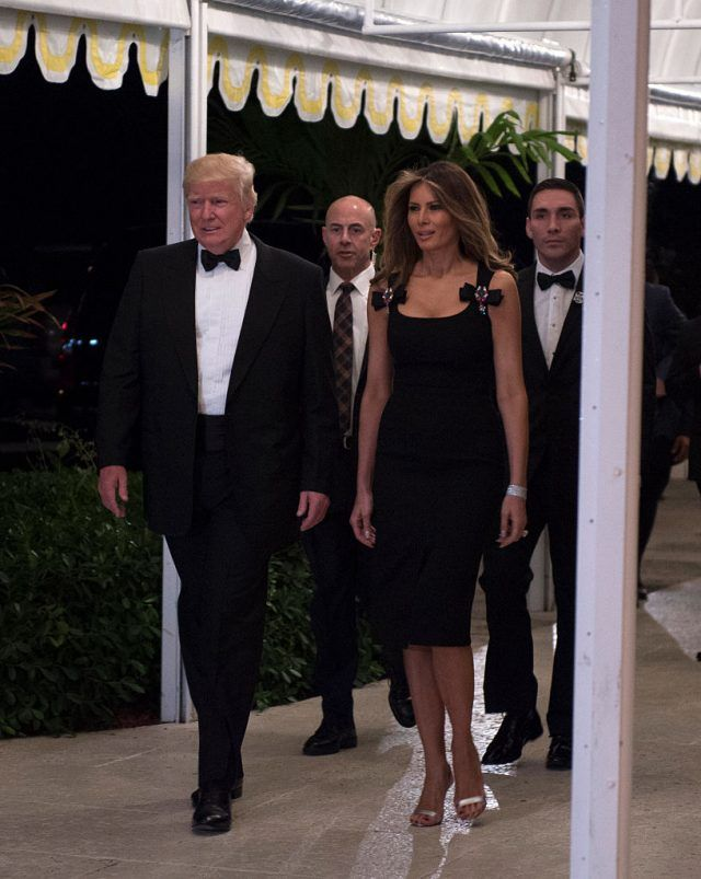 WOW! Melania just grabbed everyone's attention. The First Lady wore a black fitted dress with a modest slit up the front as she arrived at the New-Year's Eve party. She looked AMAZING! Eric Trump and Donald Trump Jr. were also there, along with Sylvester Stallone and his wife. At one point President Trump was asked …
