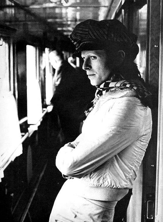 David Bowie inside a Soviet train car, traveling through USSR from Japan with his band members in 1973.