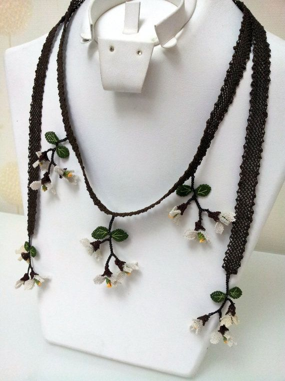 brown base white and yellow spring flowers long by berratosun, $90.00
