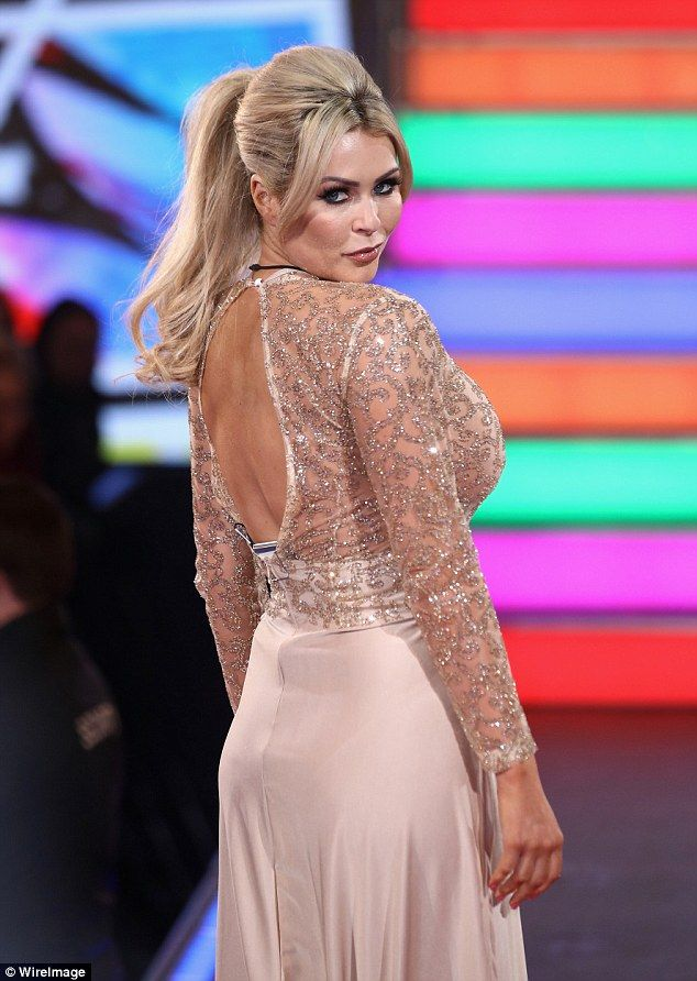 Strike a pose: The dramatic ensemble was semi-backless and showed off the star's toned fig...