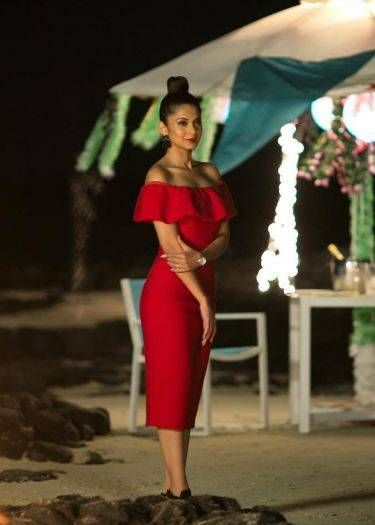 Romance in Red. Jennifer Winget looks ready for a romantic evening in her off-shoulder red midi dress. The high top bun aptly contrasts the ruffled flare at the dress's shoulder. https://www.estrolo.com/whatstrending/cat/celeb-style/  #offshoulderdress #reddress #eveningwear #statementearrings #JenniferWinget #Celebstyle #NewYearStyles #NewYearFashions #BollywoodFashion