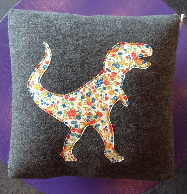 Dinosaur pillow by dreamfly