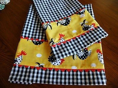 "tweaked kitchen towels - ""Look what a difference a little fabric and rick rack makes."" (found here -> http://wiquilter.blogspot.com/2010/09/quick-gift-idea.html)"