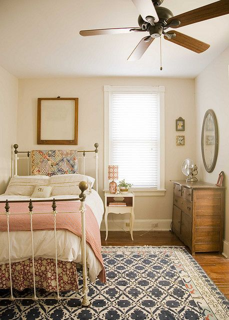 I love the different textures and patterns - I have an old iron bed like this and my great grandmother's handmade quilts... Perfect combination.