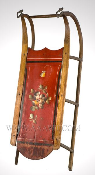 Floral decorated sled with cast iron swan finials at the end of runners. Probably from Maine.
