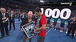 Roger Federer of Switzerland holds the Roy Emerson trophy after winning his 1000 match after the Mens final match against Milos Raonic of Canada during day eight of the 2015 Brisbane International at Pat Rafter Arena on January 11, 2015 in Brisbane, Australia.