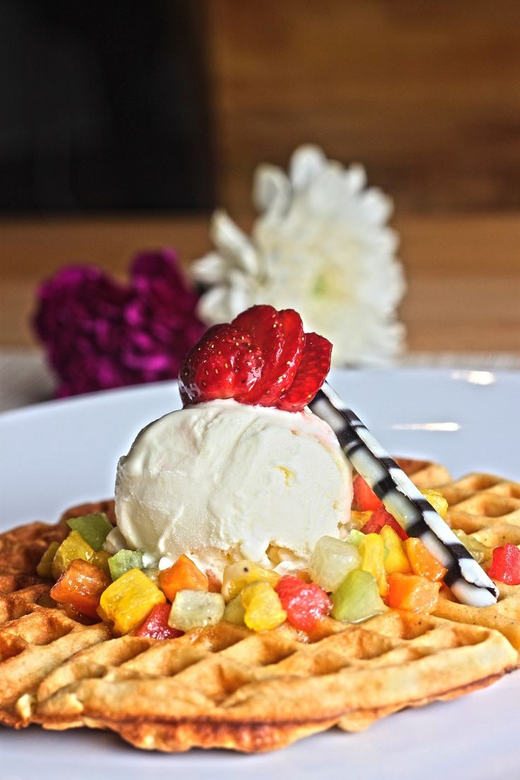 Rejuvenating vanilla ice cream with fruits on a waffle. Rp 29,900++/portion