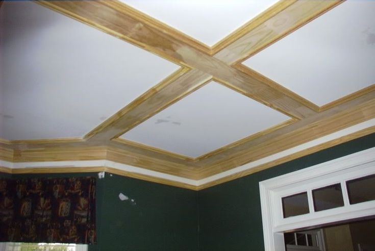 Great coffered ceiling out of simple 1X6 boards and basic trim.. Doesn't hang down as far as well.. which is good for my master.