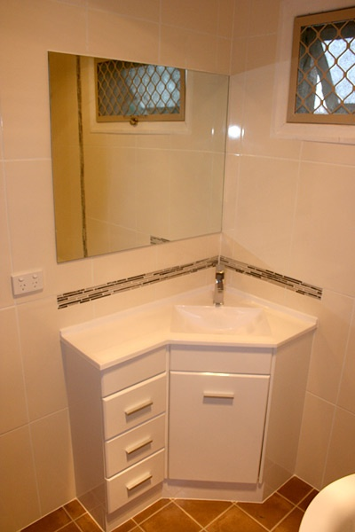 Small Corner Units with feature tiles - Bathroom Renovations Brisbane