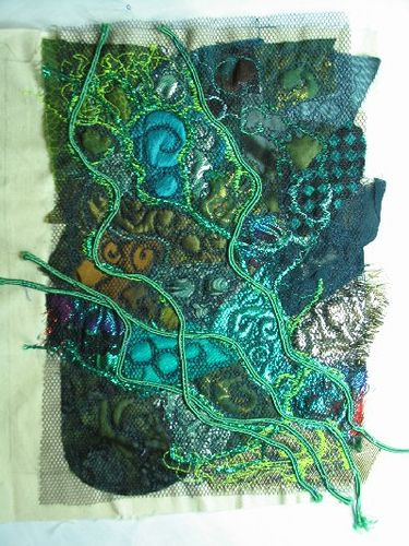 Nice colours & texture.  fabric book page by gramarye, via Flickr