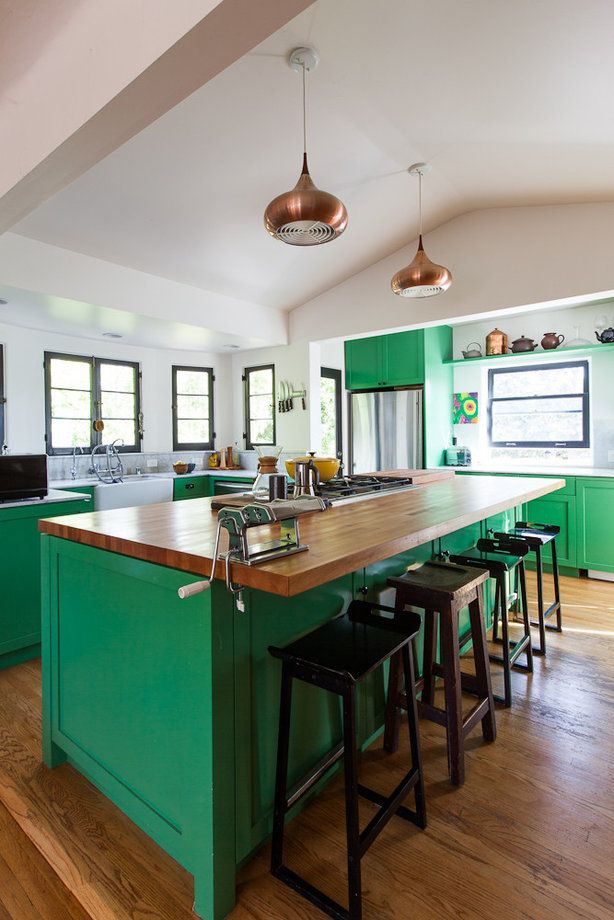 """""""Architect Bestor took out overly deep cabinets, lifted the ceiling and expanded into a laundry room. The result was more space and more light"""""""