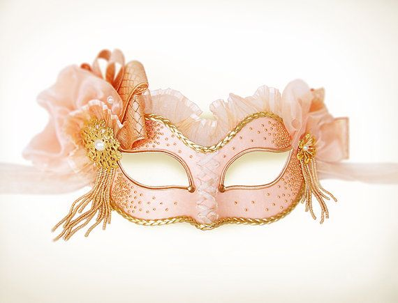 Handmade Venetian style masquerade mask in Victorian style. Front surface is covered with light salmon pink fabric and sand beads. Decorated with fabric rosette, faux pearls, gold braided trim, frill, rhinestones and metallic gold accents.  Worldwide delivery within 4 business days with online tracking.  Back surface is also covered with fabric for comfortable use. Ribbons added both sides to tie. Base mask is made of paper mache. Standard size fits most (for women). This classical Venetian…