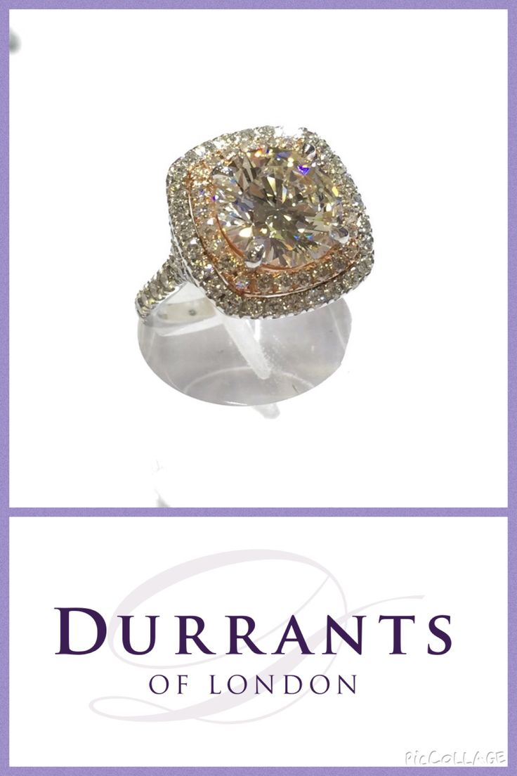 4.14ct H VS1 round brilliant cut diamond set in our handmade double halo ring. Ade in 18ct rose and white gold.