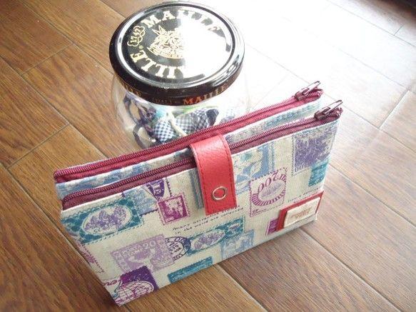 front very*ご覧頂きありがとうございます(*゚▽゚*)Wファスナーの母子手帳が入るお財布です。切手柄の生地に留める部分に赤のフェイクを合わせてみまし...|ハンドメイド、手作り、手仕事品の通販・販売・購入ならCreema。