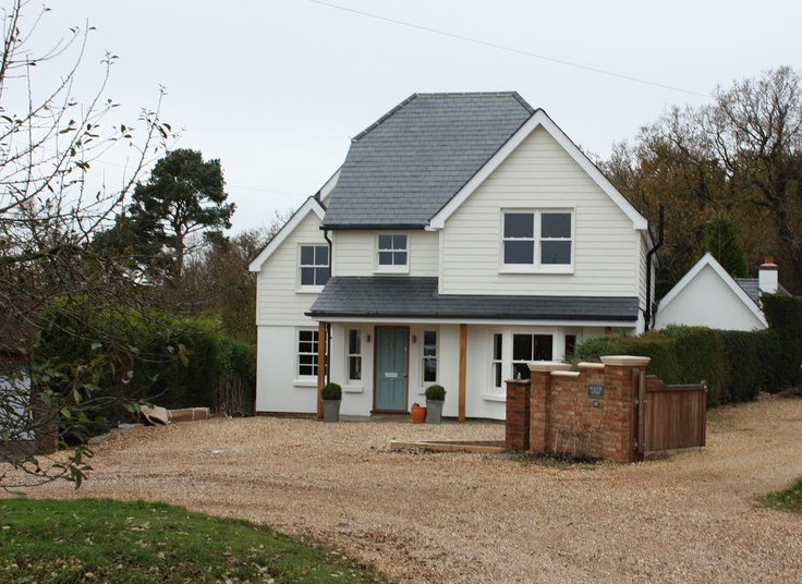 Farnham remodelling project. The completed home in a New England style. The ingredients of this home included timber sash windows, slate roofing and timber clap board in varying quantities.