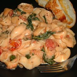 Creamy Tomato and Spinach Tortellini (going to try it with Fat Free Half & Half instead of heavy cream)