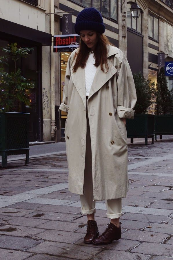 Trench Coat:a double-breasted jacket ,raincoat,has a military collar,pockets,belt,and a strap near the bottom of each sleve.