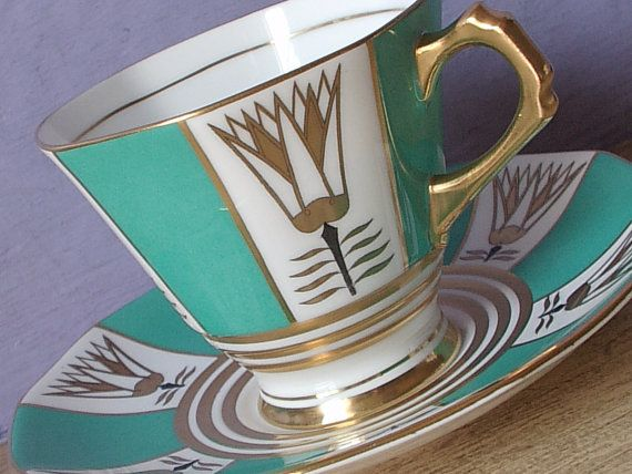 Vintage 1950s Mid Century Modern Teacup and Saucer, Tuscan turquoise green and Gold tea cup, English teacup, Antique Bone china tea cup  This great set has the mark first used in 1947.  It is a standard size set.  No chips. No cracks.  ***A Top-rated teacup shop on the internet lists this set for $125! Mine is PRICED TO SELL!  I have more teacups available:  https://www.etsy.com/shop/ShoponSherman?section_id=7698939&ref=shopsection_leftnav_1  I have more vintage & antique items in my shop…