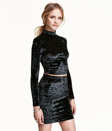 Short mock turtleneck top in crushed velvet with long sleeves.  Concealed zip at back of neck.