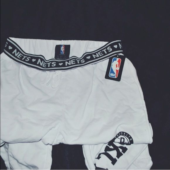 NBA New York Nets Logo Sweatpants NBA New York Brooklyn Nets Logo Banded Sweats; NWT; Never Worn; Purchased online for $27.90; Logo down left leg; Run small Forever 21 Pants Track Pants & Joggers