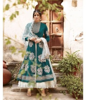 Glorious Green Georgette Designer Suit $128.33. Make royalty a part of your wardrobe with the Glorious Green Georgette Designer Suit from the house of Lurap. The fine georgette fabric of the kameez brings out the best of the designer embroidery that embellishes it. The white bottom and dupatta complement the beautiful green kameez to perfection.