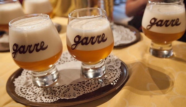 "The special De Garre Tripel, made by Van Steenberge. Only available at one location, the tiny alleyway bar of ""De Garre"" in Brugge."