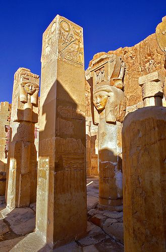 The Temple of Hathor is part of The Mortuary Temple of Queen Hatshepsut. Hathor is depicted as a cow goddess with head horns in which is set a sun disk