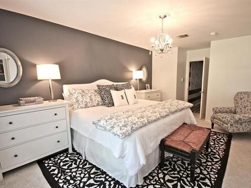 I like the idea of two smaller chest of drawers on each side of the bed