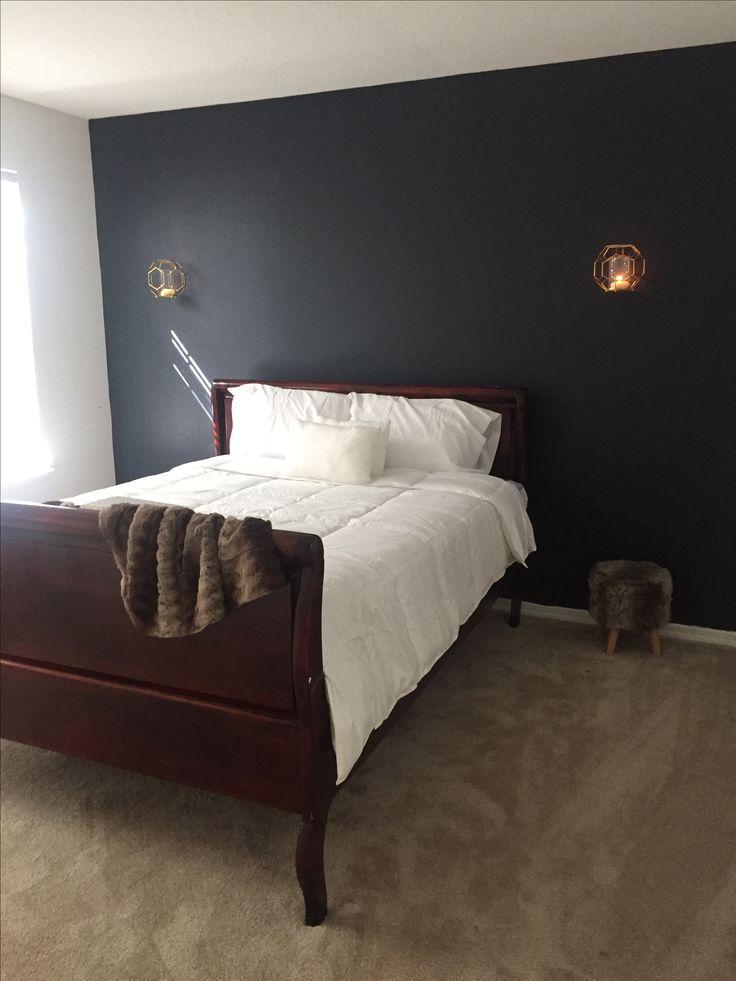 Benjamin Moore Halenavy guest room ideas navy  sleigh bed cherry wood fur throw