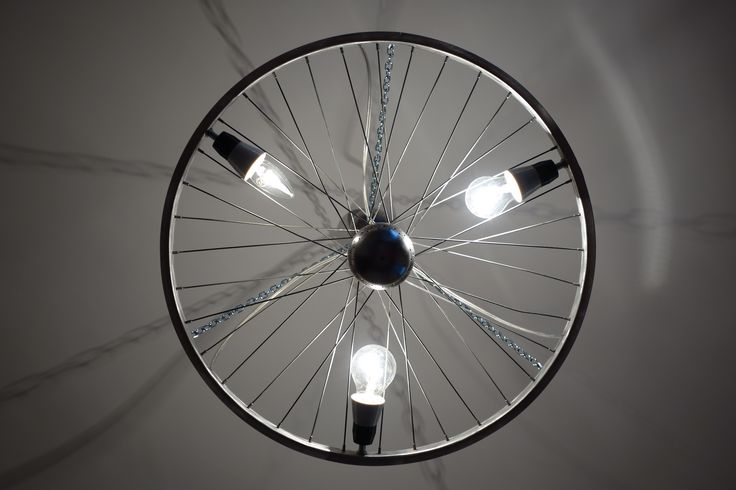 """Giro"" chandelier made from an old bike wheel on the 100th anniversary of Giro d´Italia 2017"