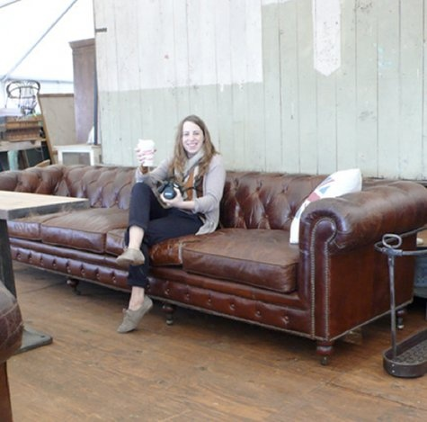 this leather sofa is huge . bet perfect for falling asleep on it .