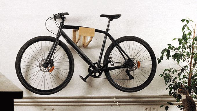 HOOK   bike wall rack design by ARTHUR RICHARD  machined in solid oak made with TheFabFamily