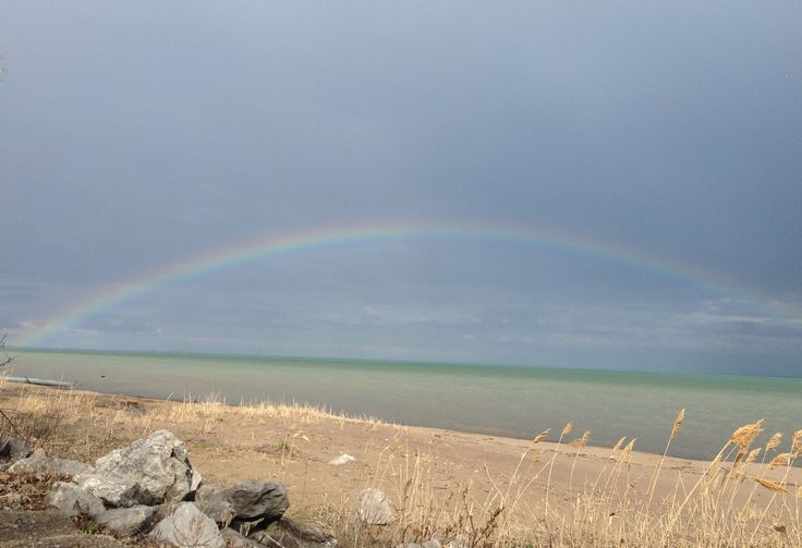 The beautiful full arc of a rainbow in Turkey Point.